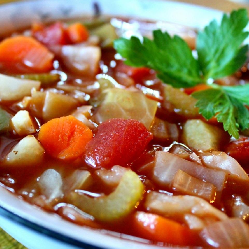 bowl of cabbage soup with parsley garnish