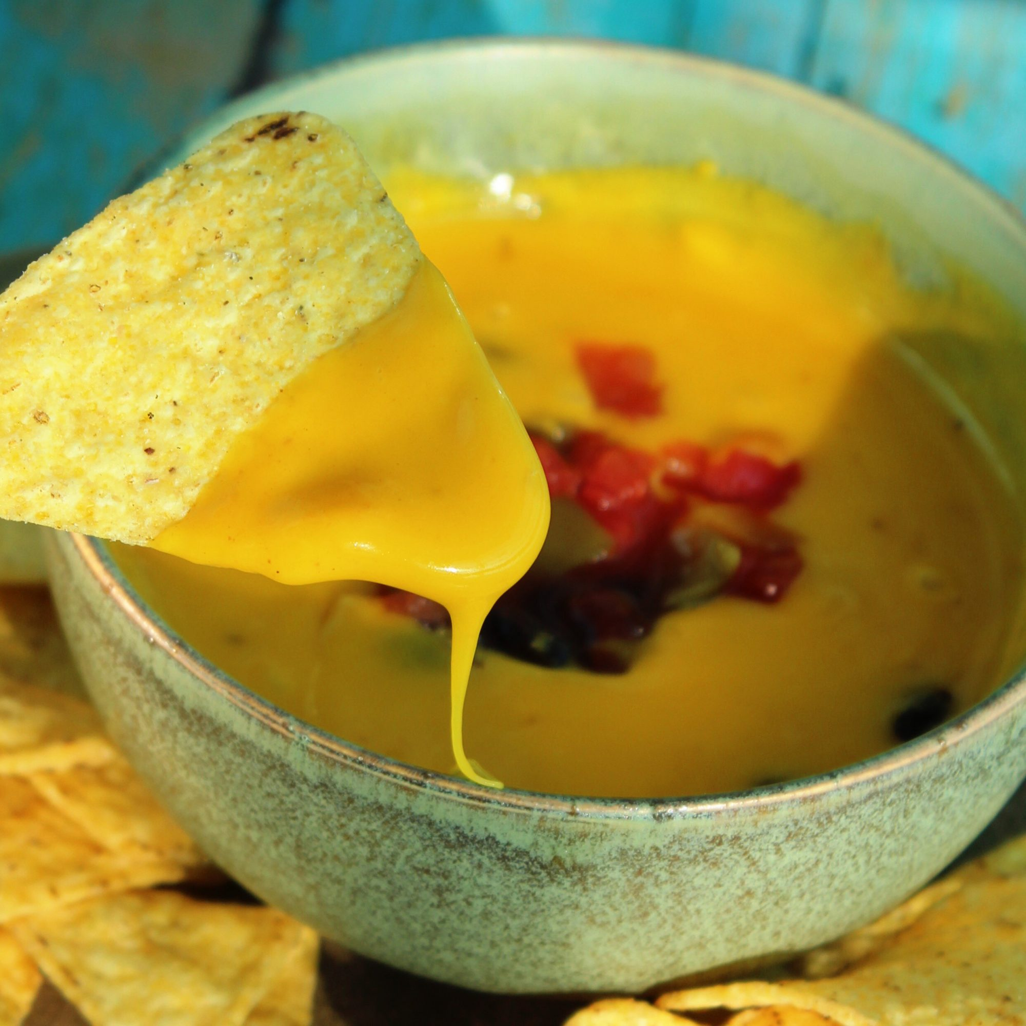 Jacked-Up Vegan Queso in a bowl with chips