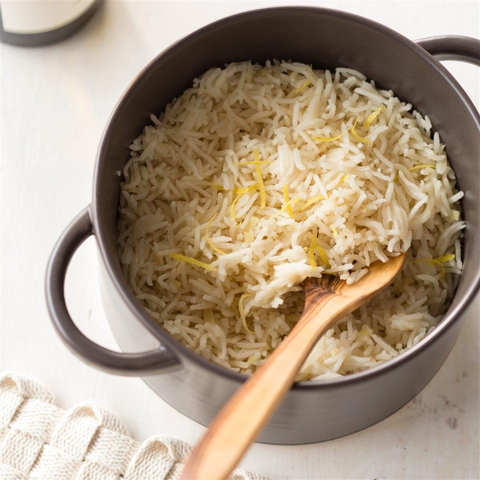 Lemon basmati rice in pot with wooden spoon