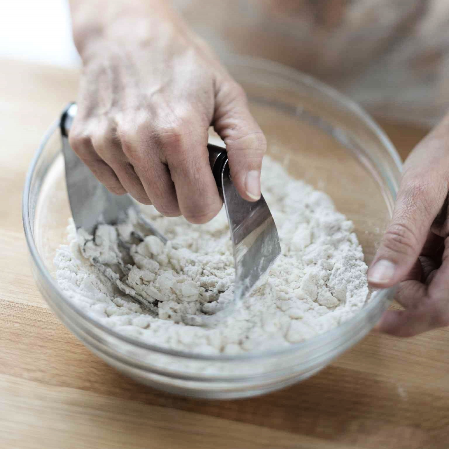 cutting fat into flour with a pastry cutter