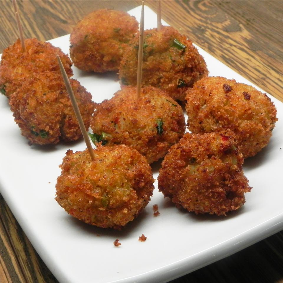 crawfish balls with toothpicks on a white dish