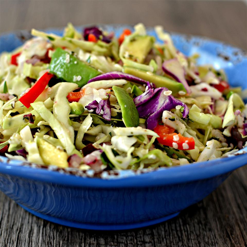 tight side shot of slaw in bright blue bowl