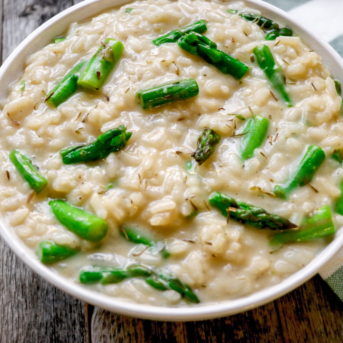 asparagus risotto in a white bowl
