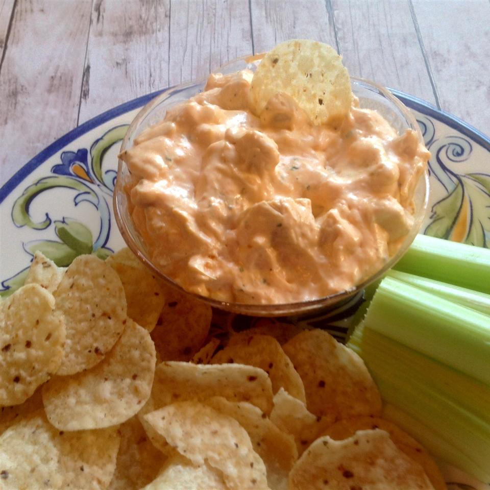 Buffalo dip, tortilla chips, and celery on plate
