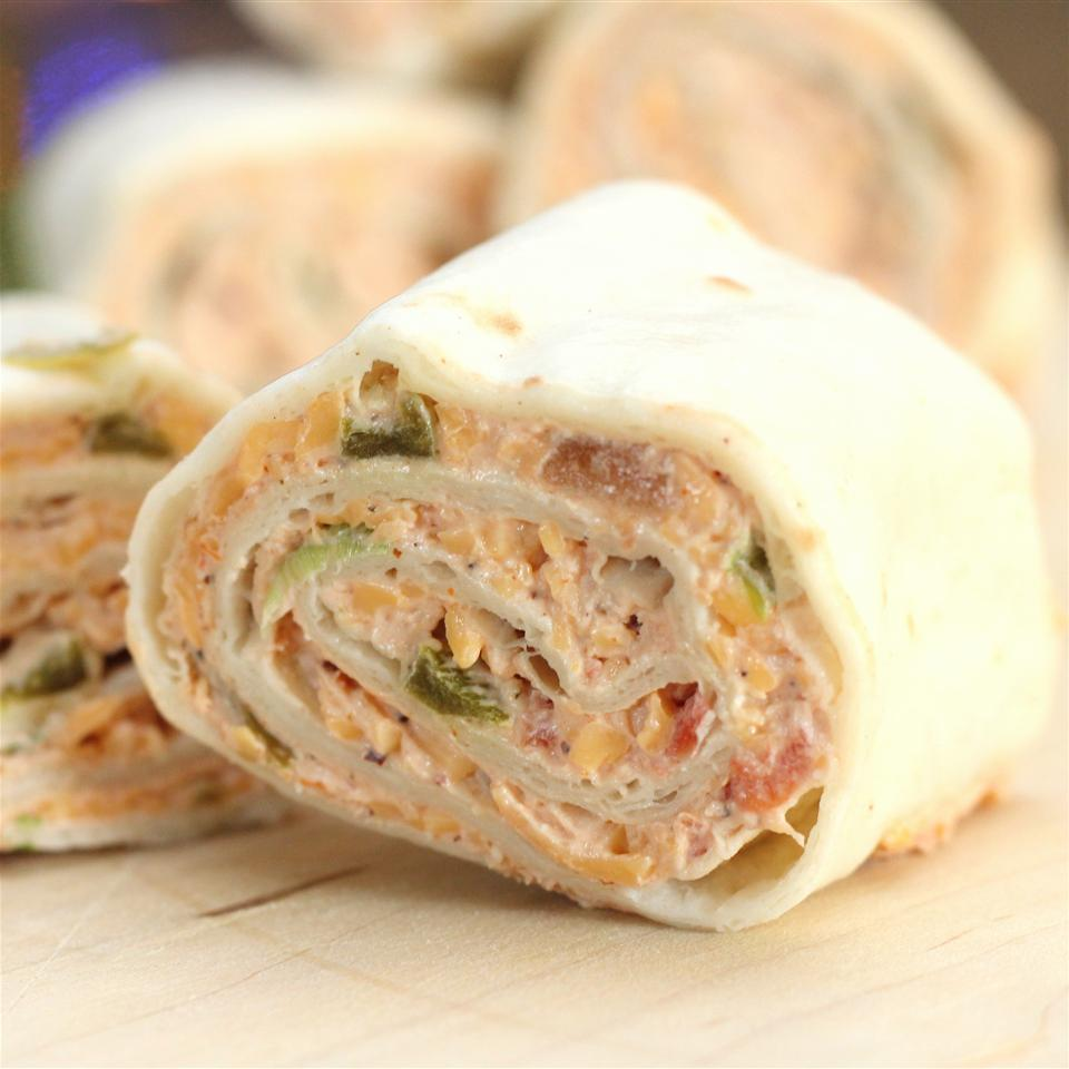 Tortilla roll up with cheese and ham inside