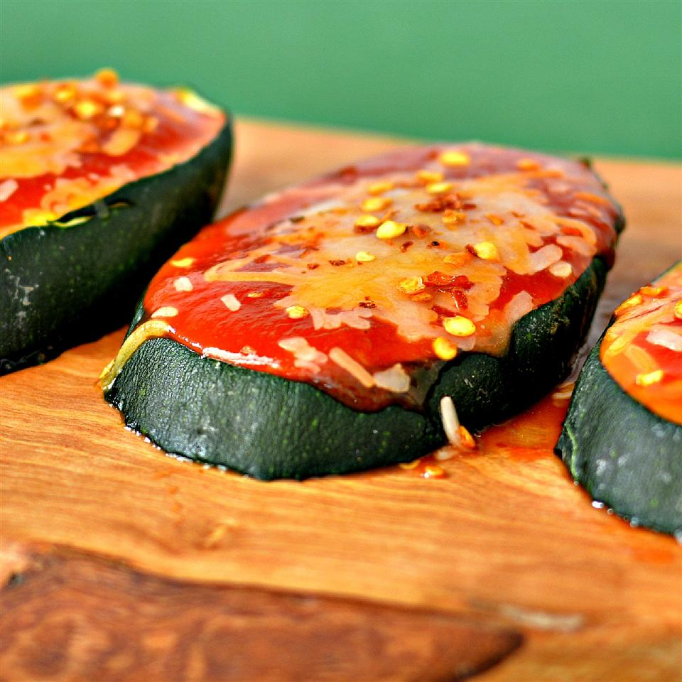 Slices of zucchini with cheese and toppings