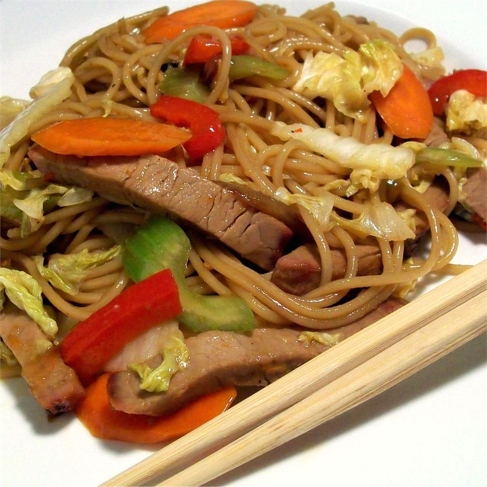 Sweet and Spicy Pork and Napa Cabbage Stir-Fry with Spicy Noodles next to chopsticks