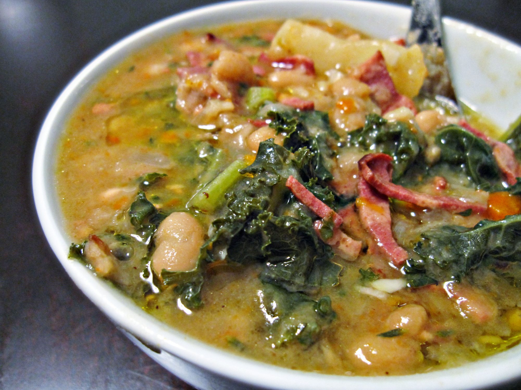 a hearty bowl of bacon, greens, and white bean soup