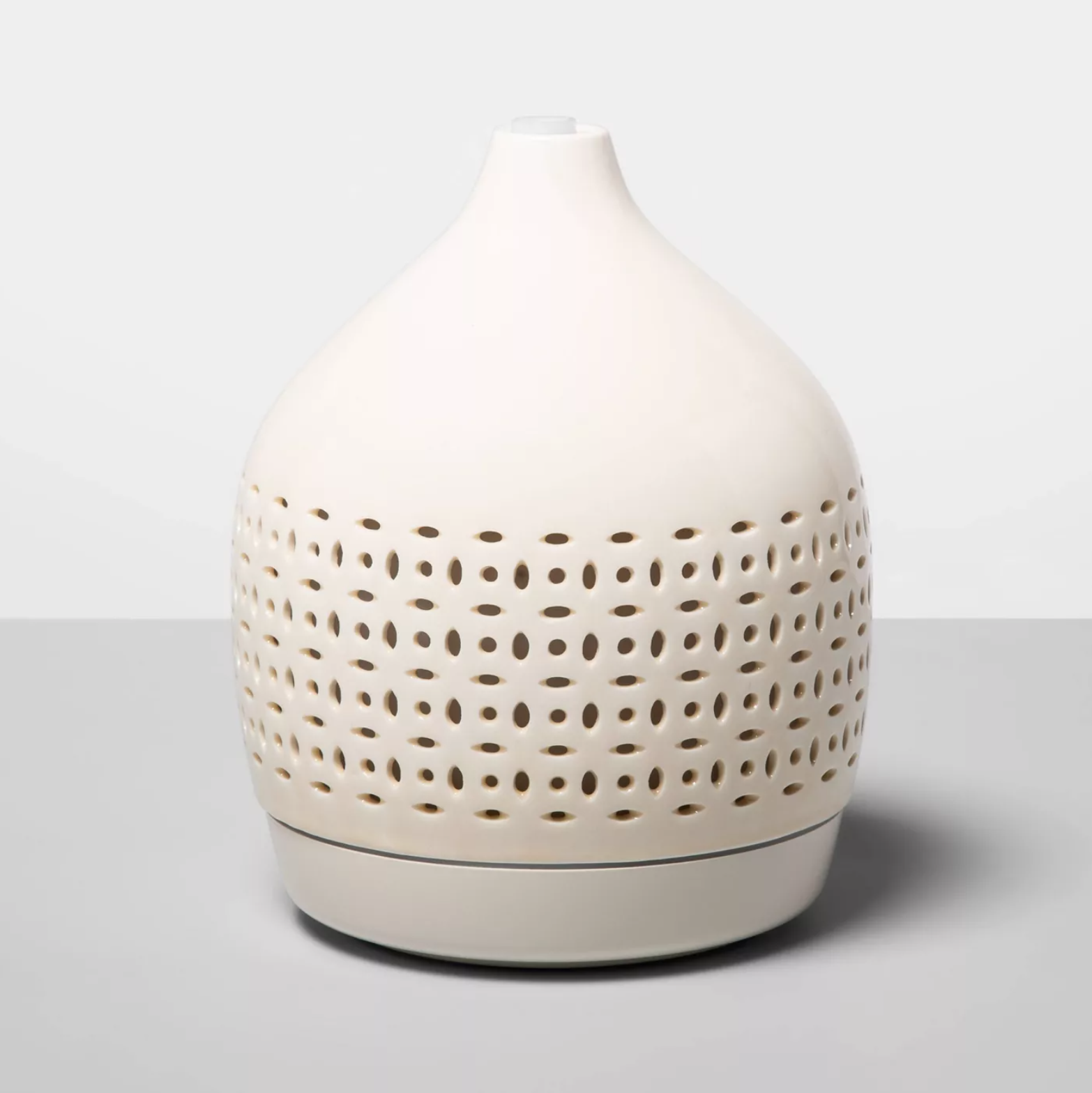 Cutout Ceramic Color-Changing Oil Diffuser on a grey background