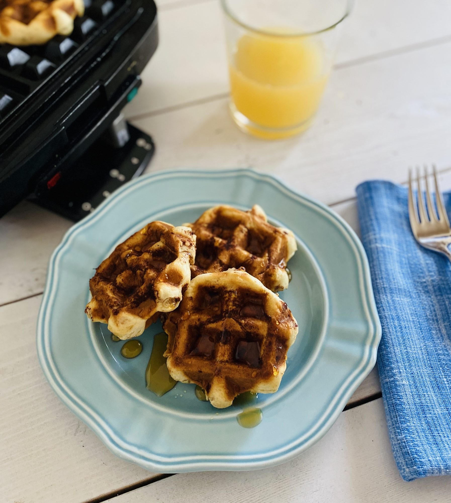 canned cinnamon roll dough baked in a waffle iron