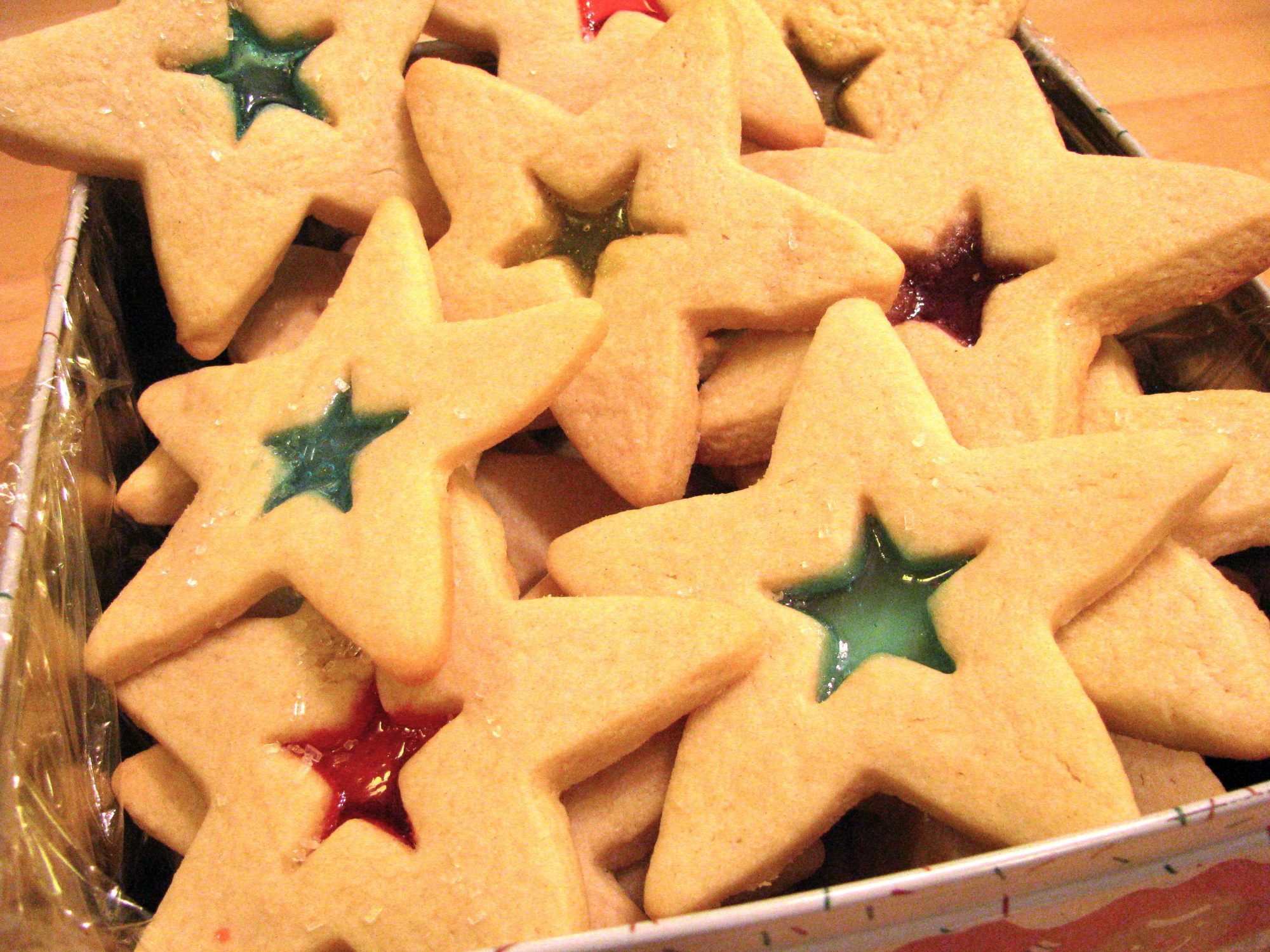 star-shaped cookies with a small star center filled with melted candies for a stained-glass effect