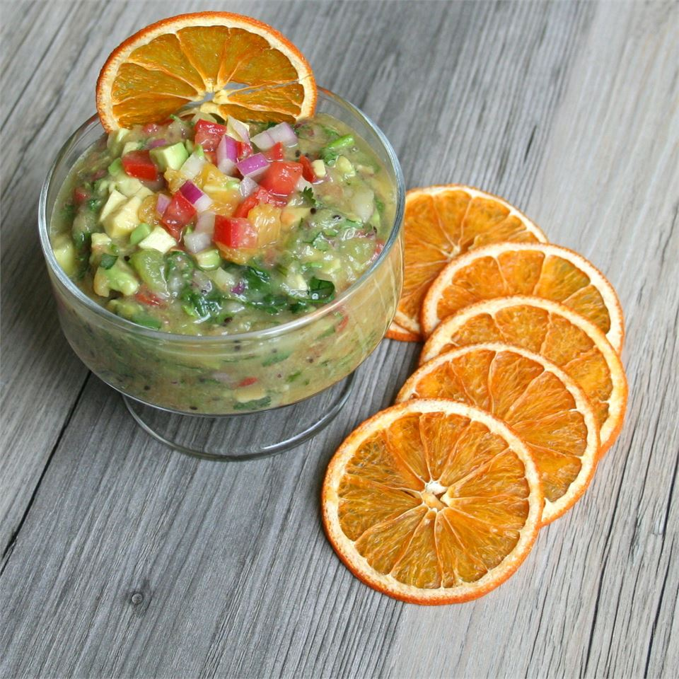 Fruit salsa in a cup with orange slices
