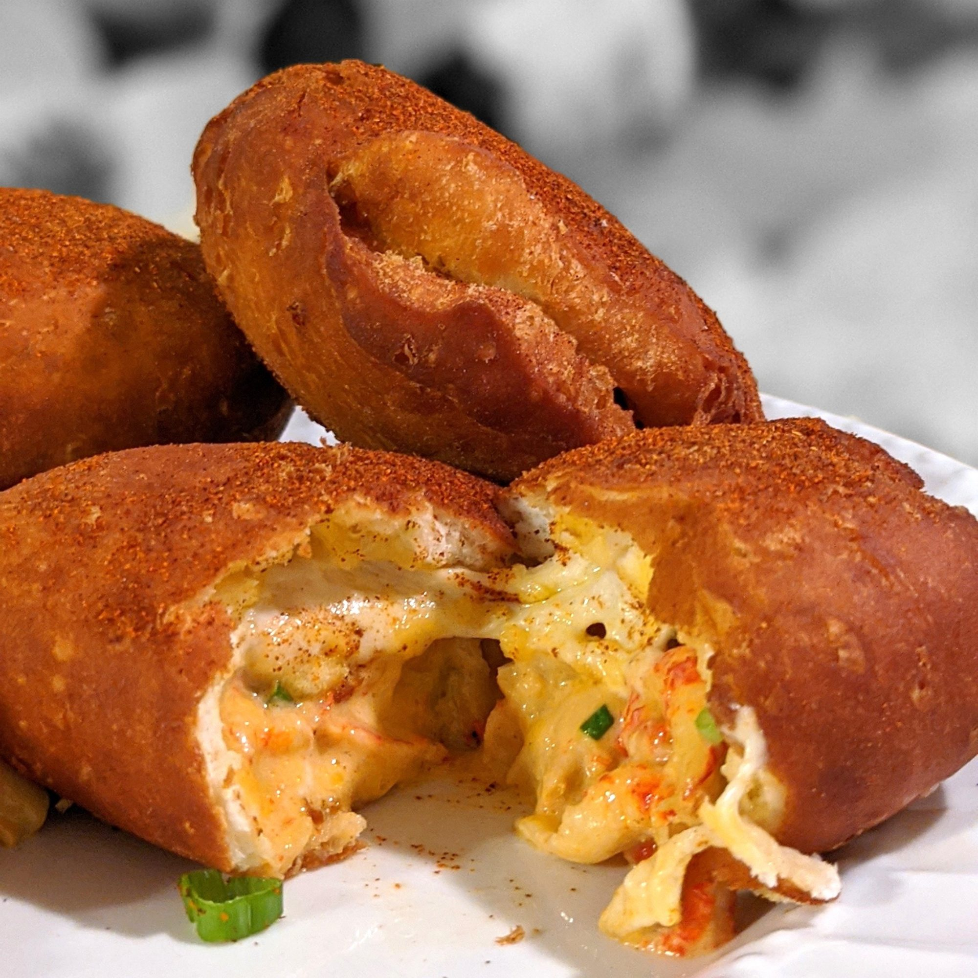 plate of savory beignets filled with cheese and crawfish