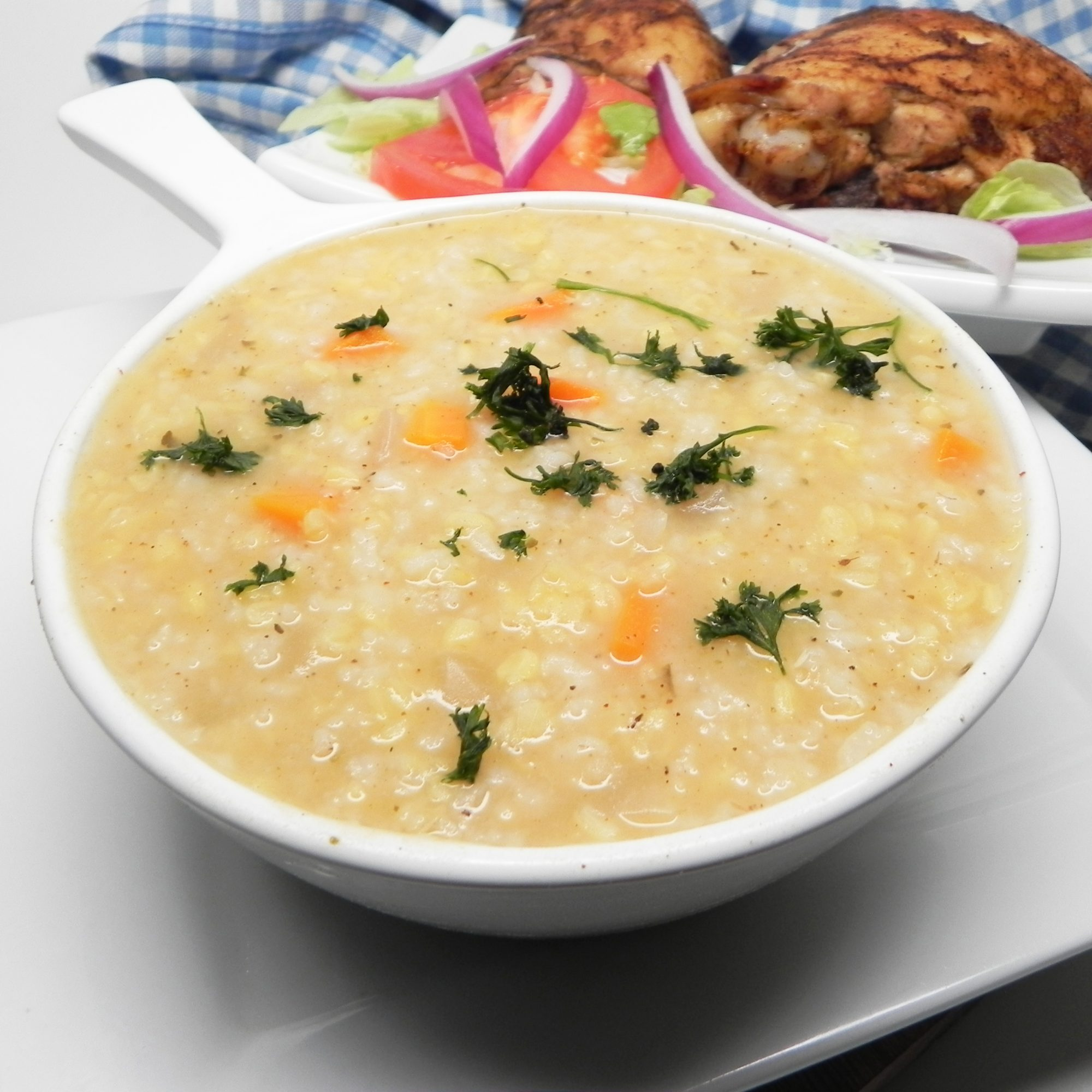 Instant Pot Lentil and Rice Soup in a white bowl
