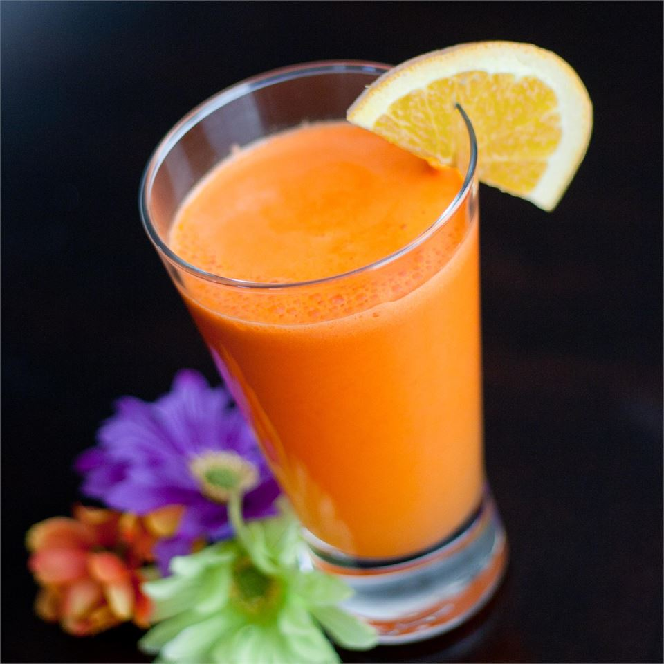 Orange in a glass with flowers