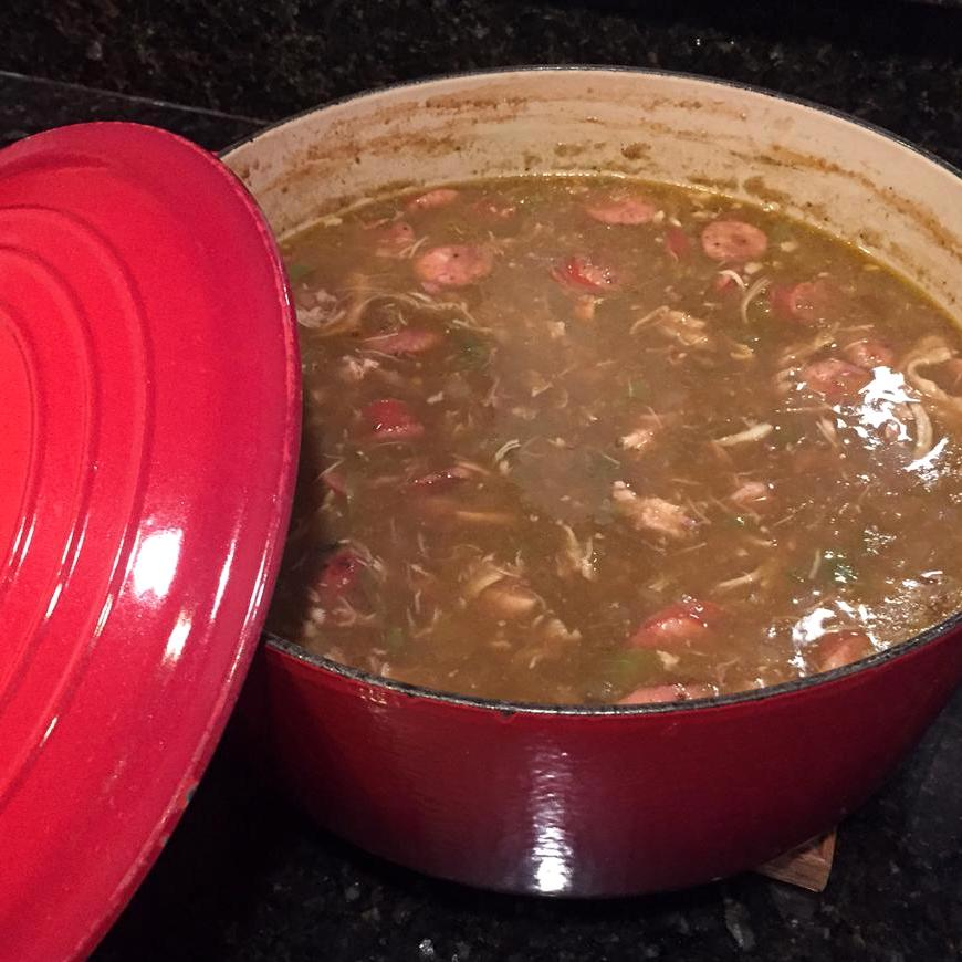 seafood gumbo in a red Dutch oven