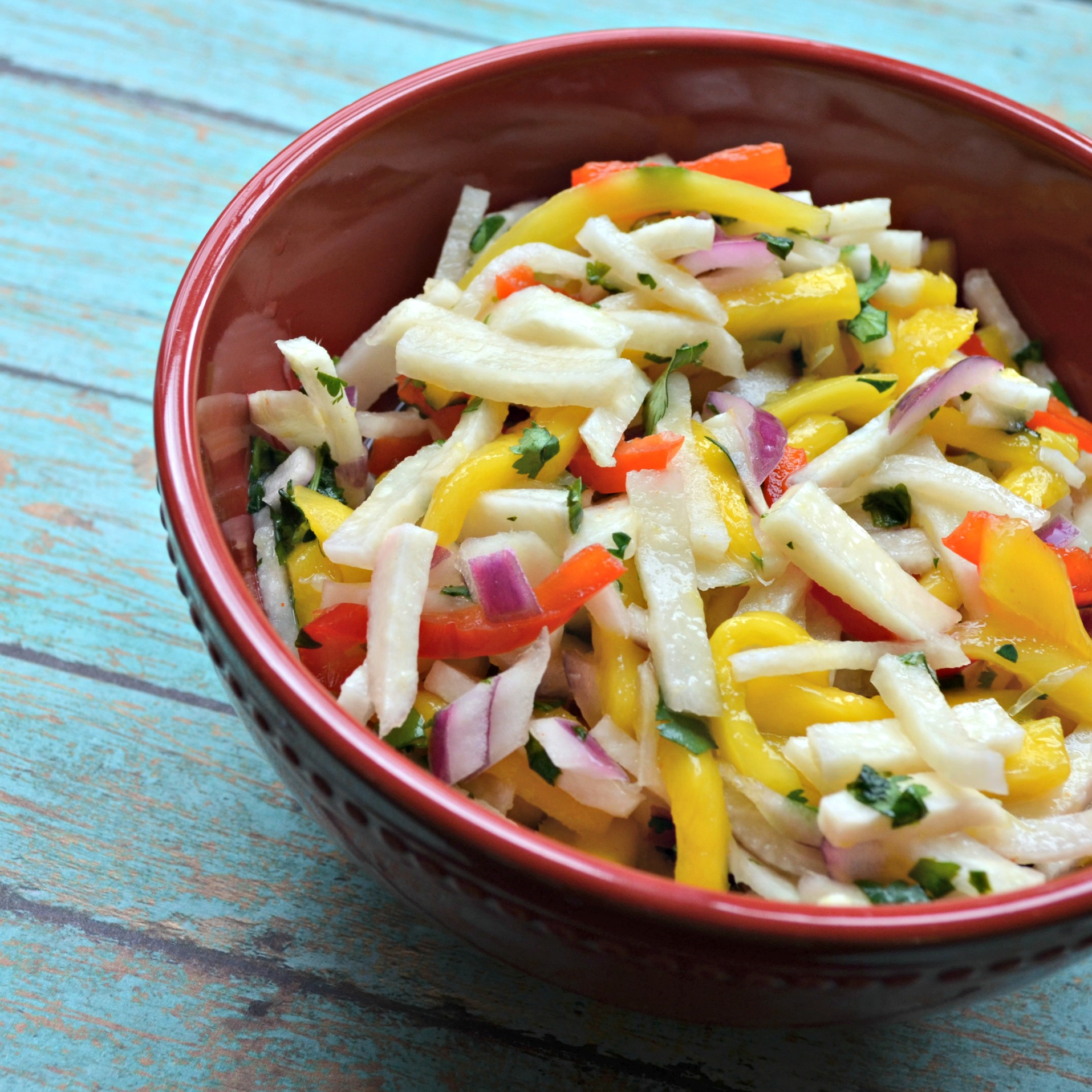 Jicama Mango Salad with Cilantro and Lime in a red bowl
