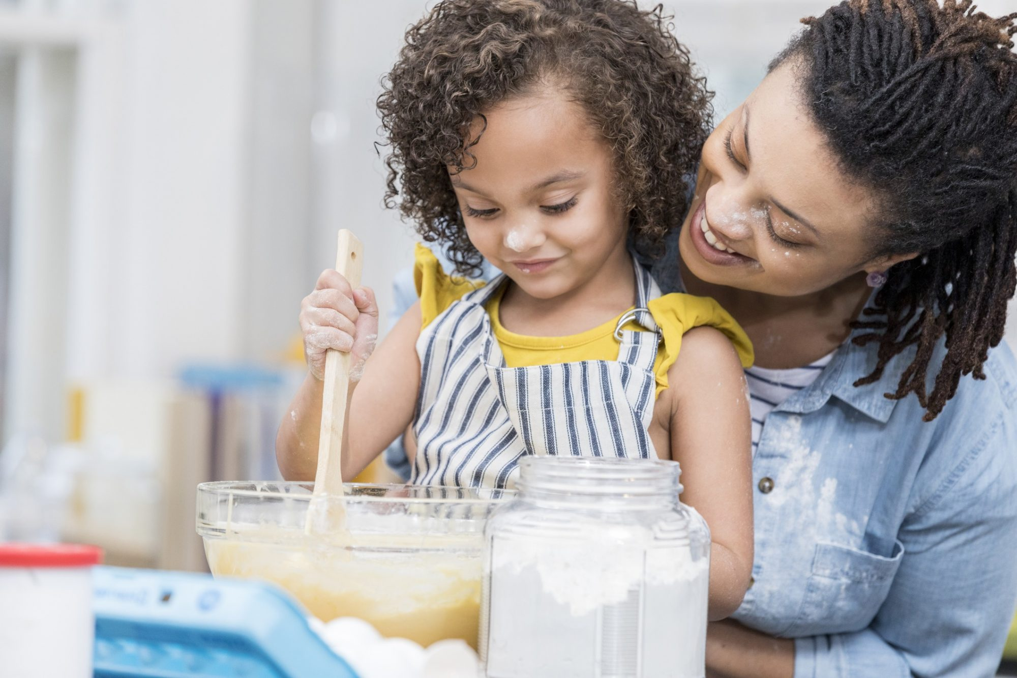mother and daughter working on a baking project together