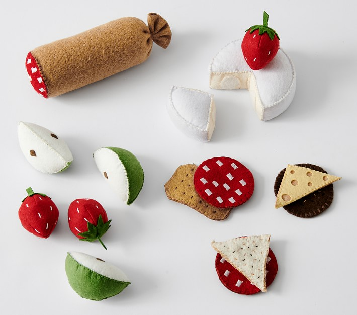 plush apple wedges, salami logs, crackers, strawberries, brie, and more