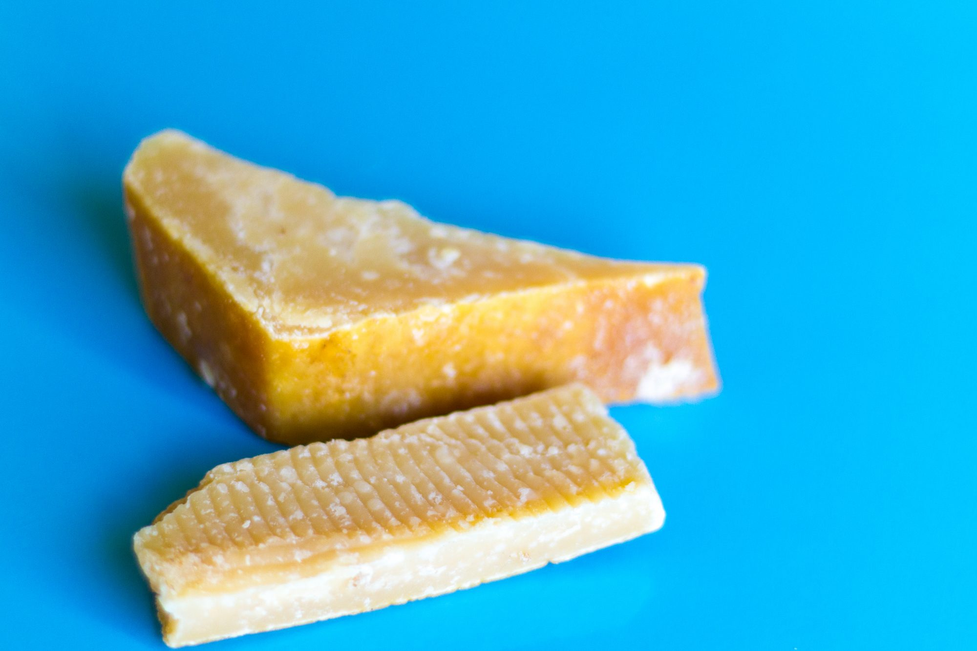 Parmesan Rinds with a Blue Background