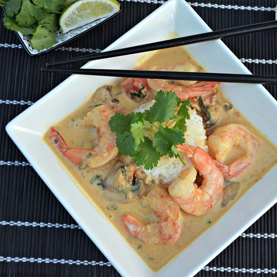 pale shrimp curry in white square bowl