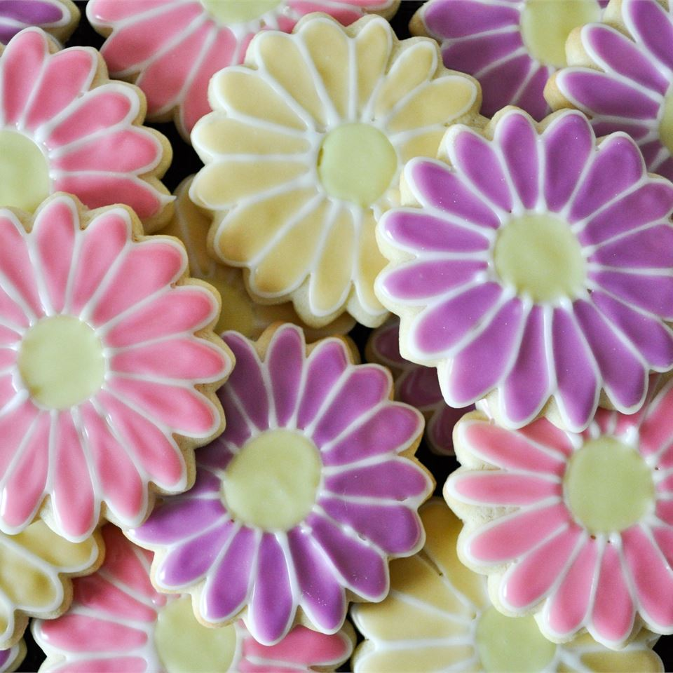 close up of sugar cookie cutouts decorated to look like flowers