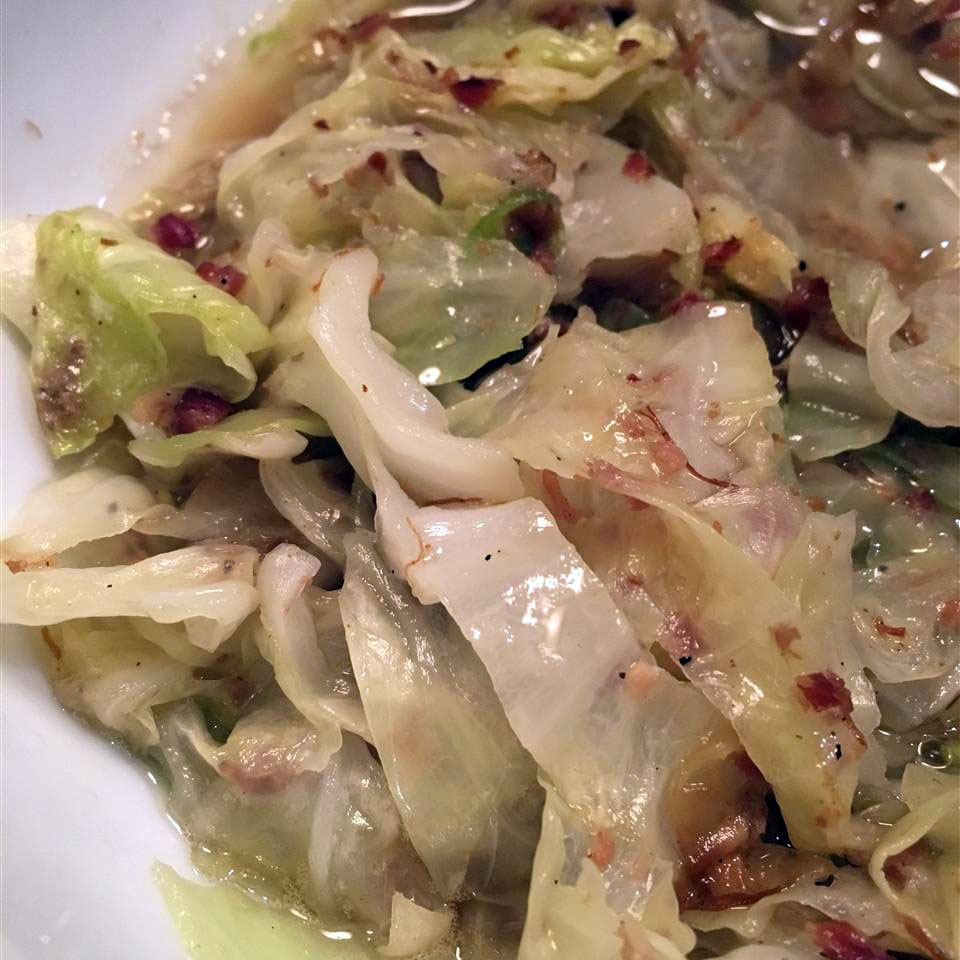 closeup of cooked shredded cabbage and bacon