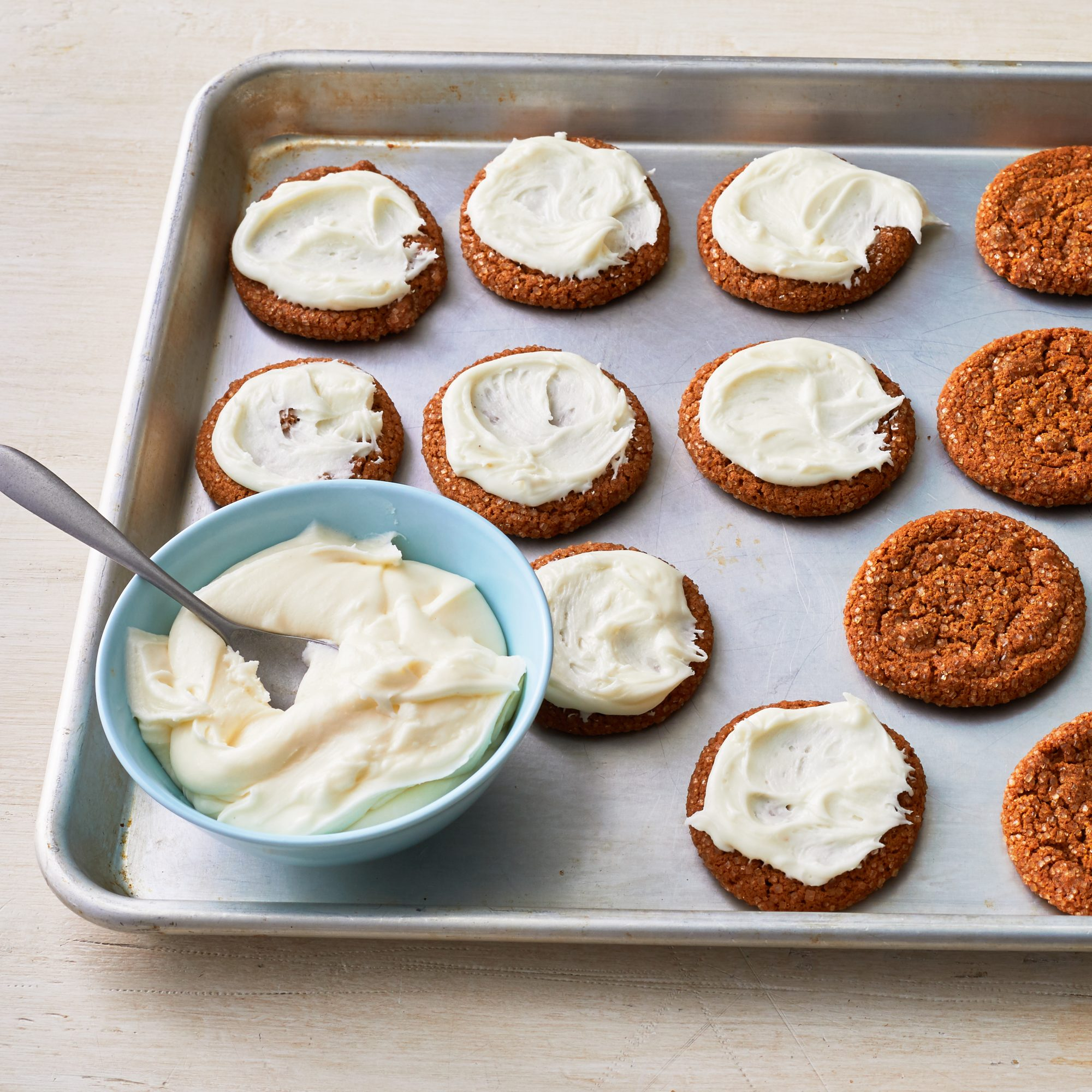 eggnog frosting on molasses cookies on baking pan