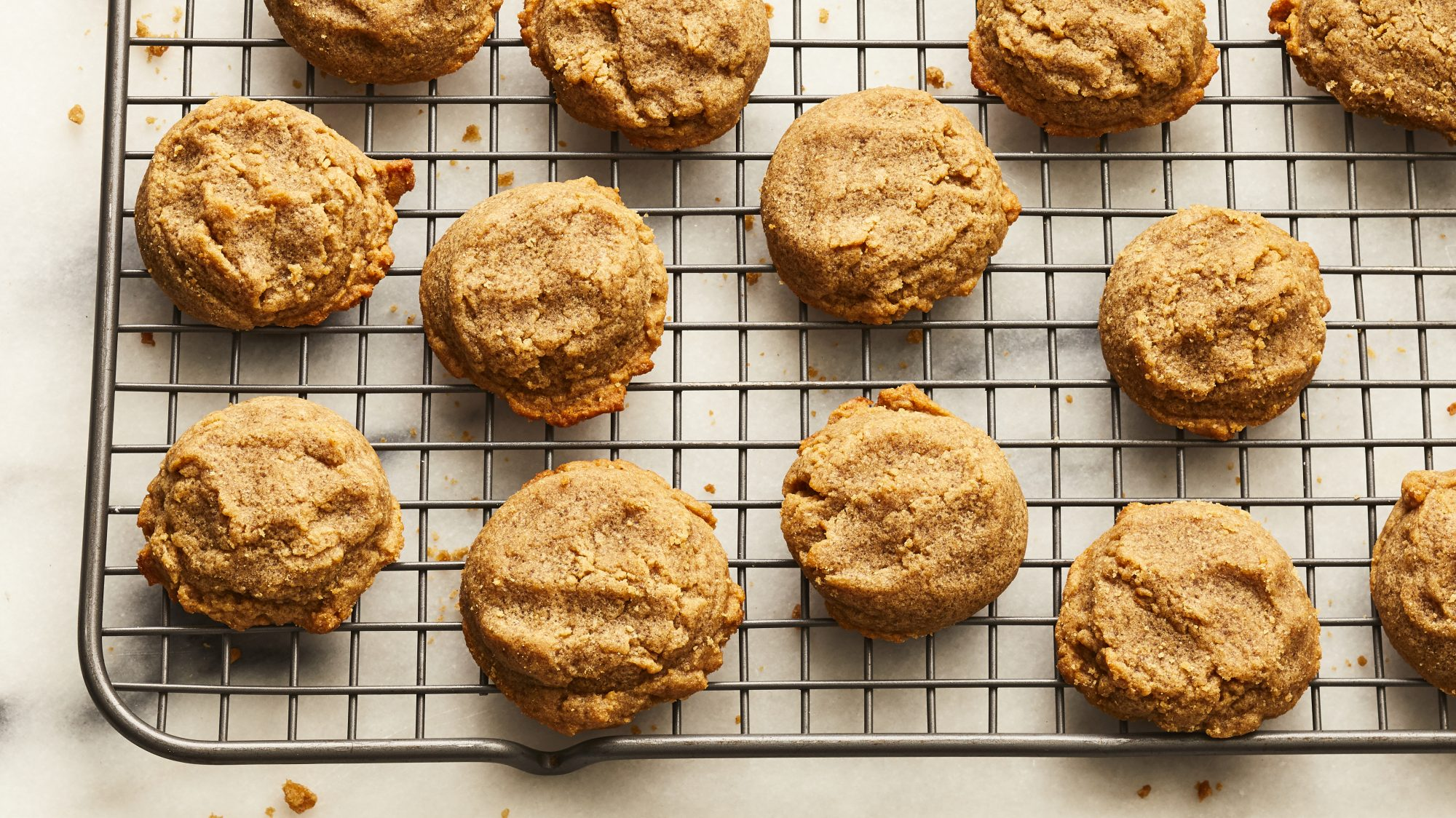 Peanut butter cookies on a wire cooling rack.