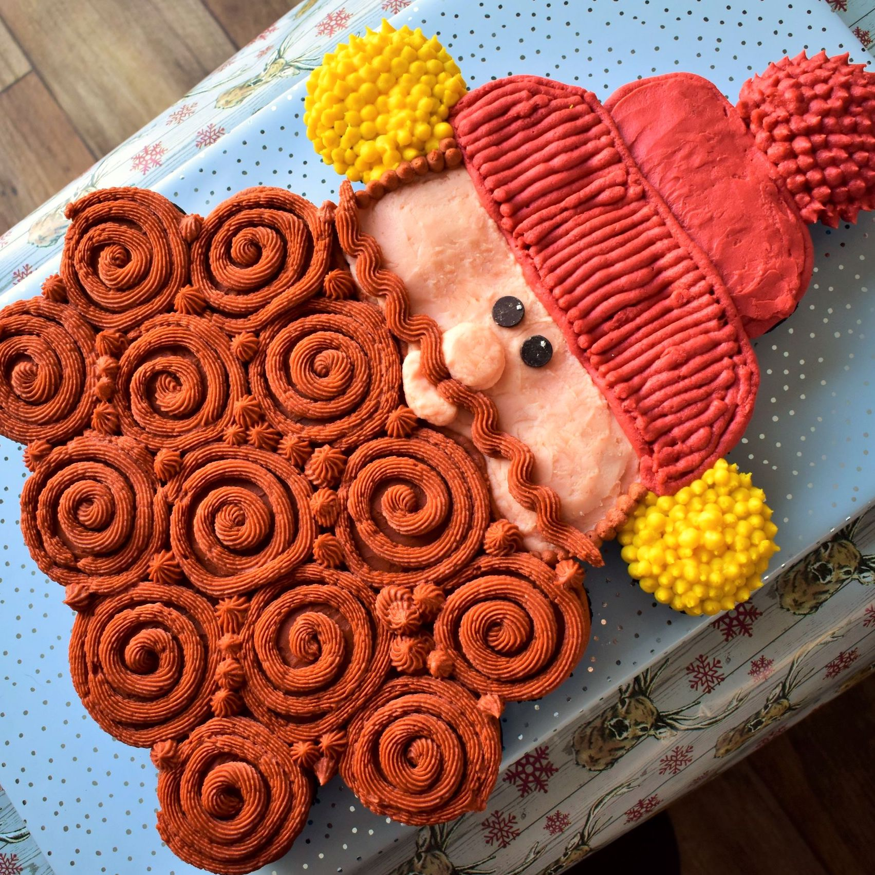 cupcake cake shaped like Yukon Cornelius character from Rudolph the Red-Nosed Reindeer