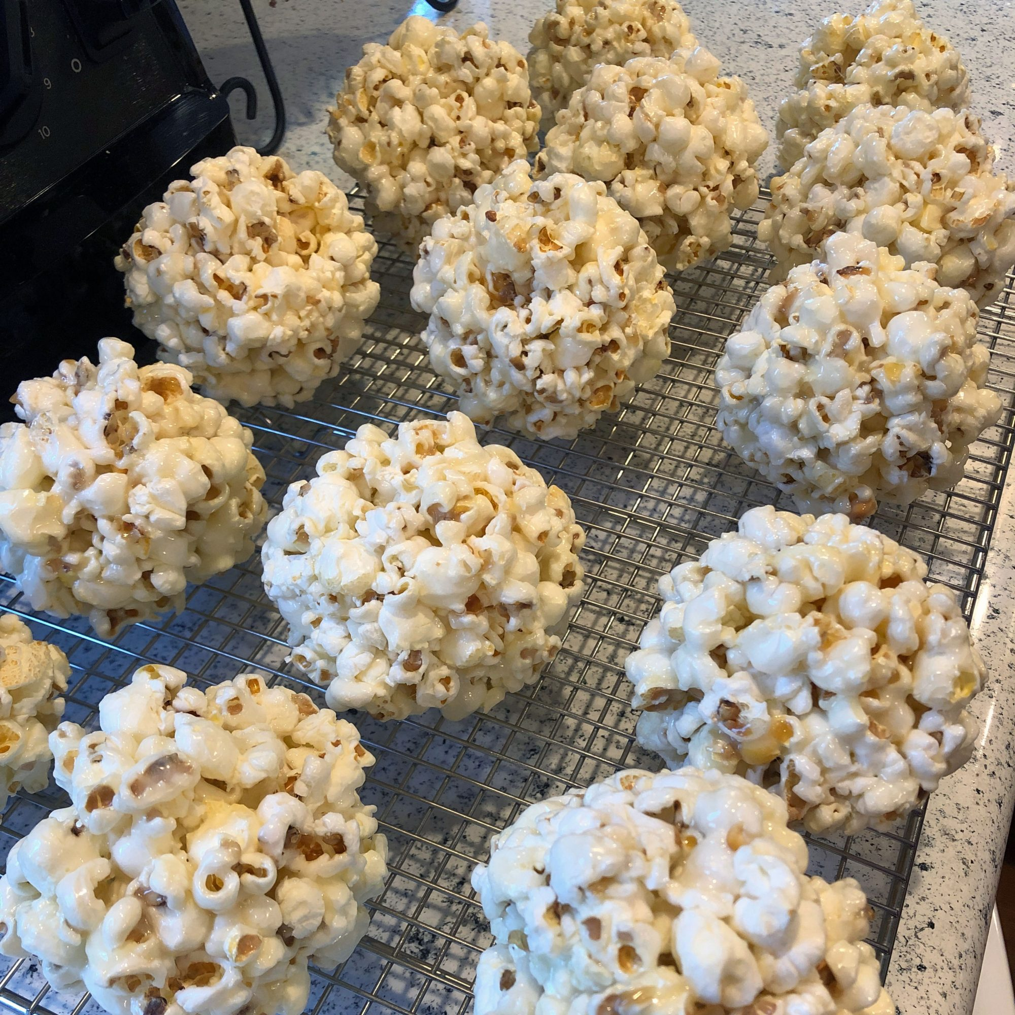 popcorn balls on a cooling rack