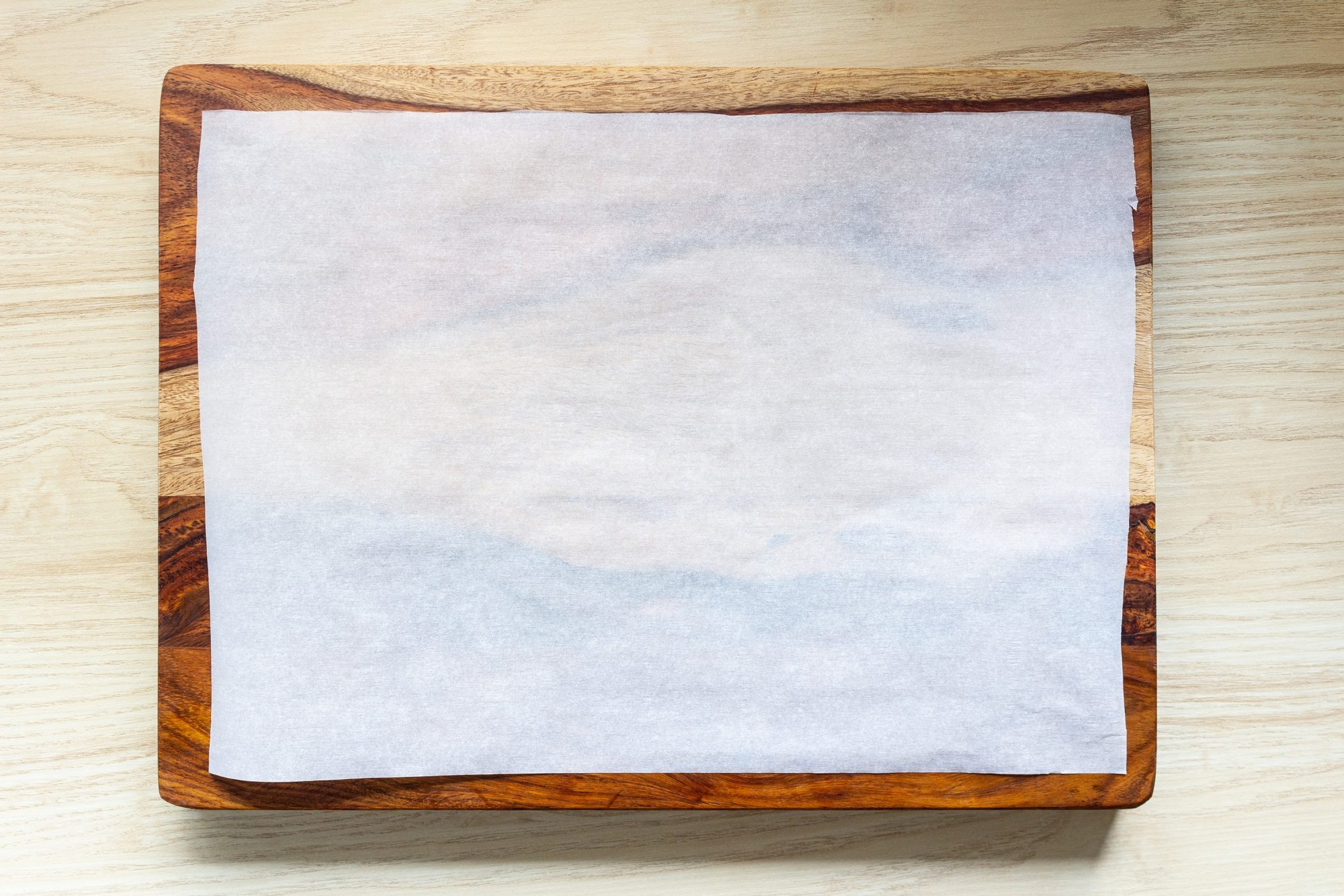 sheet of parchment paper on a cutting board