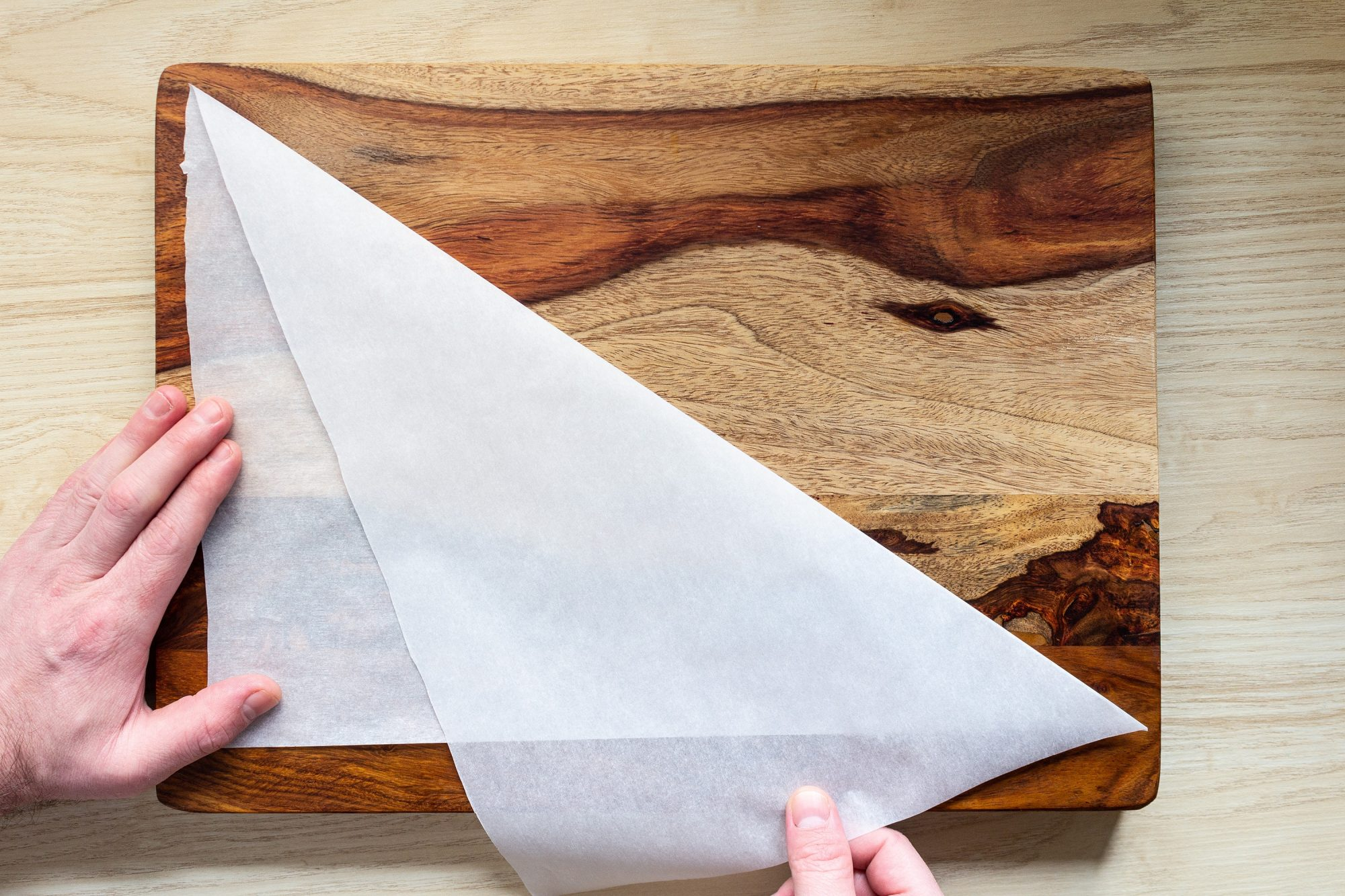 folding parchment rectangle into two triangles