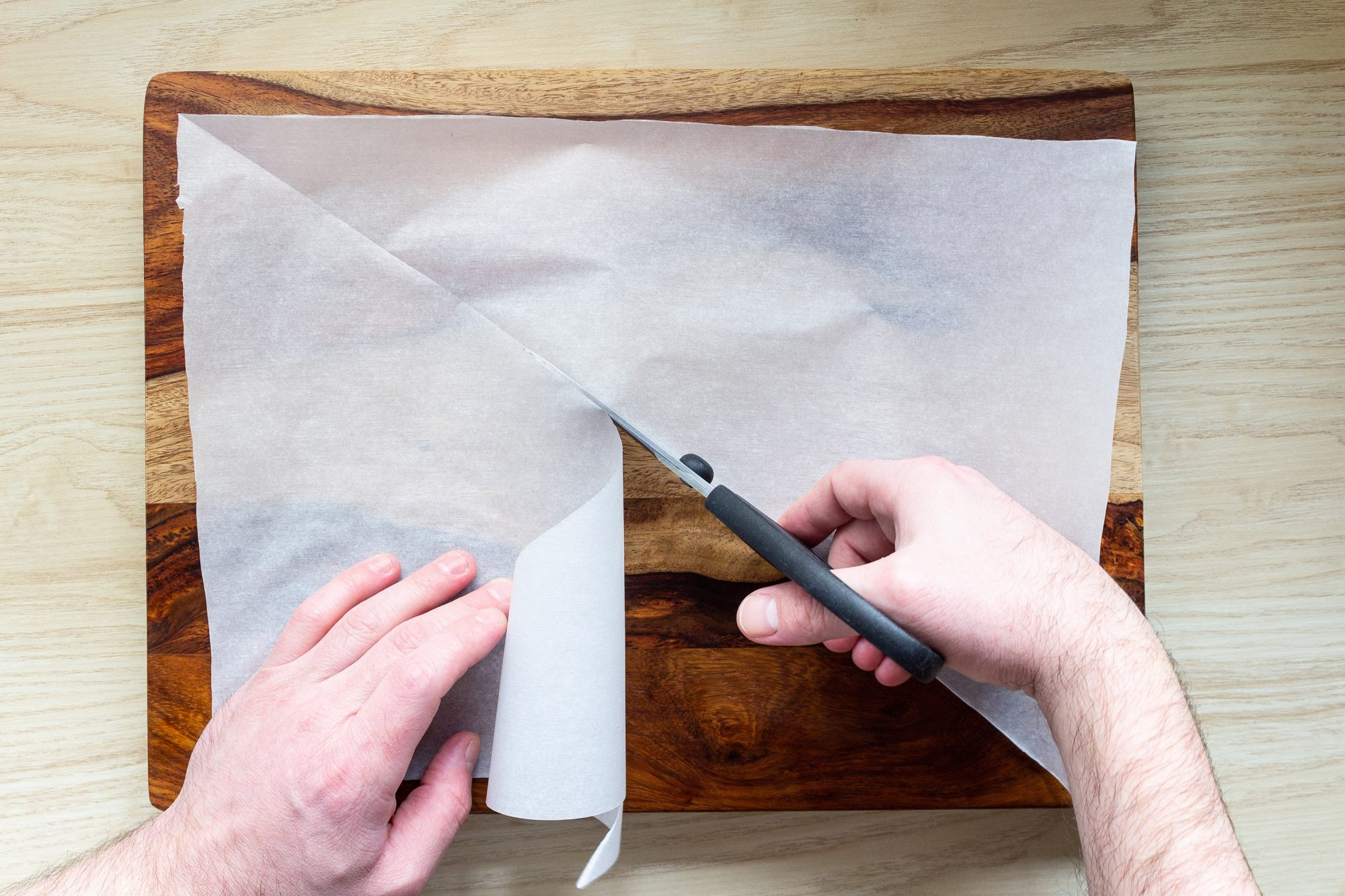 cutting a parchment paper rectangle into two triangles