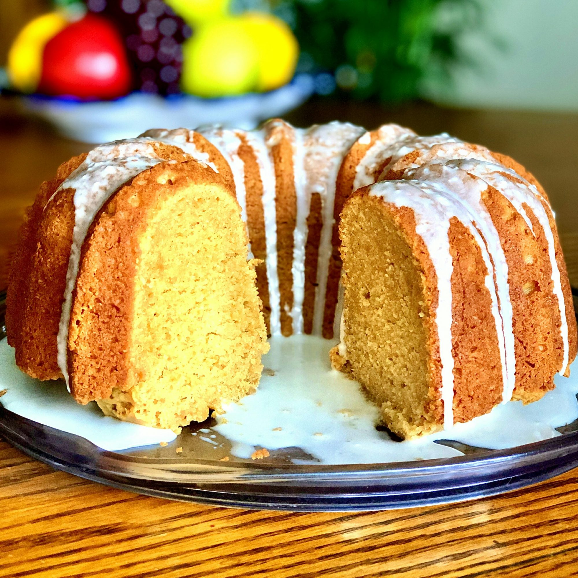 sweet potato bundt cake with glaze and slice cut out