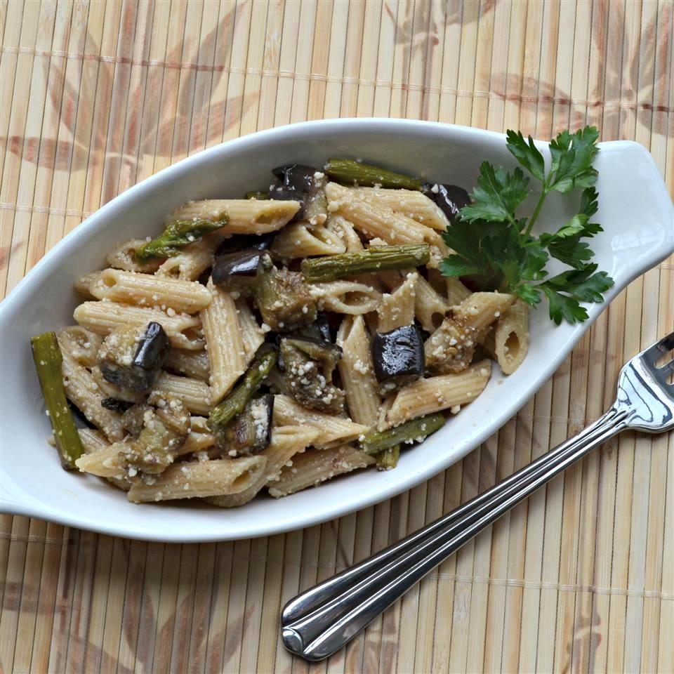 eggplant and asparagus pasta in an oval dish