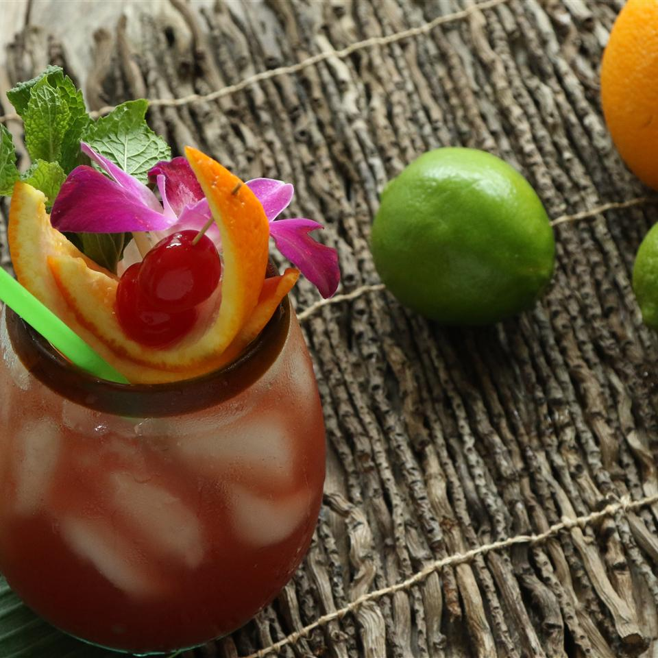 tropical rum drink with fruit garnish