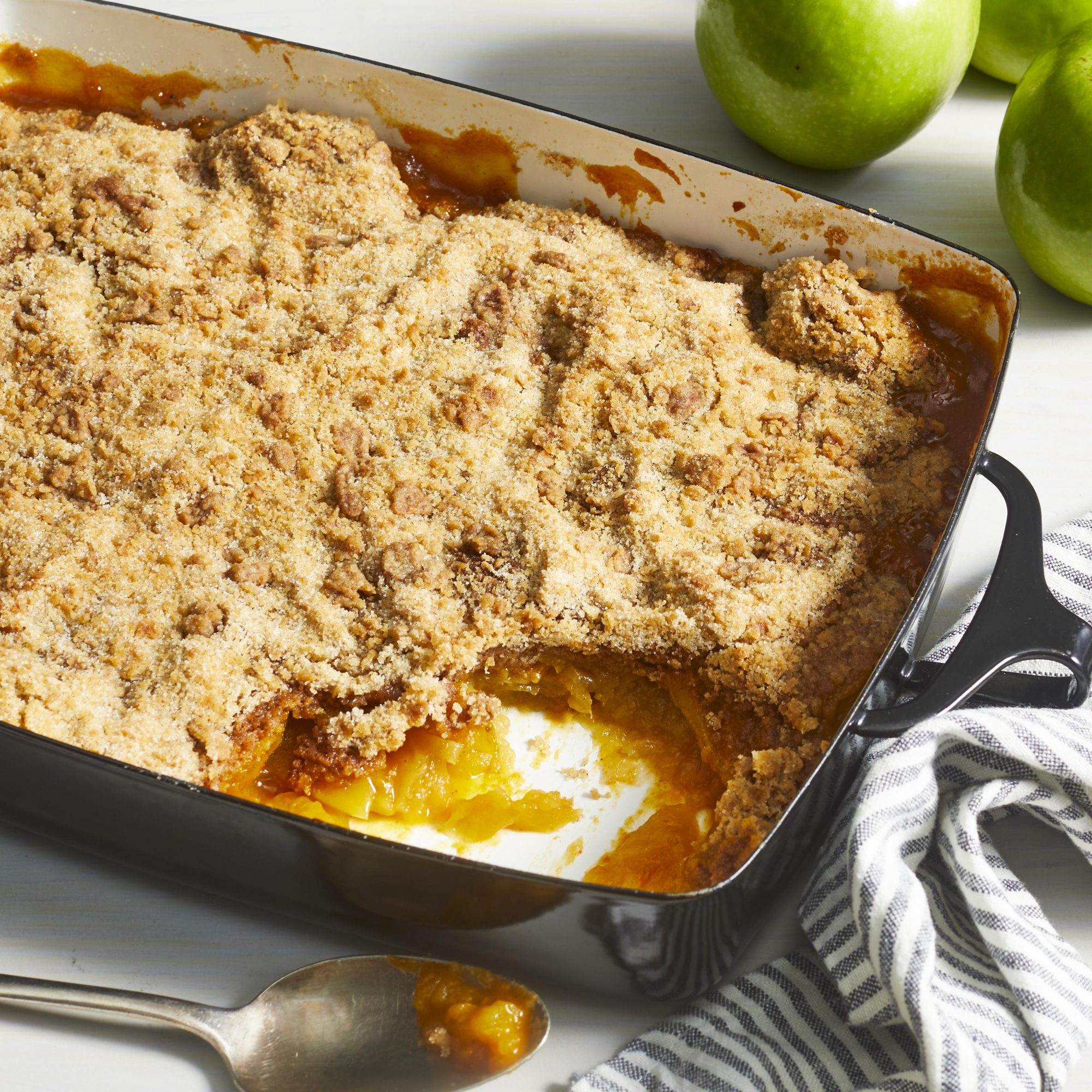 Cobbler baked in a 9x13-inch casserole pan with a scoop removed.