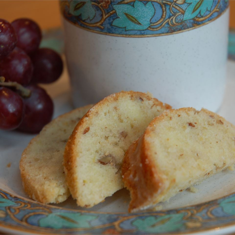 slices of lemon pecan pound cake on a plate