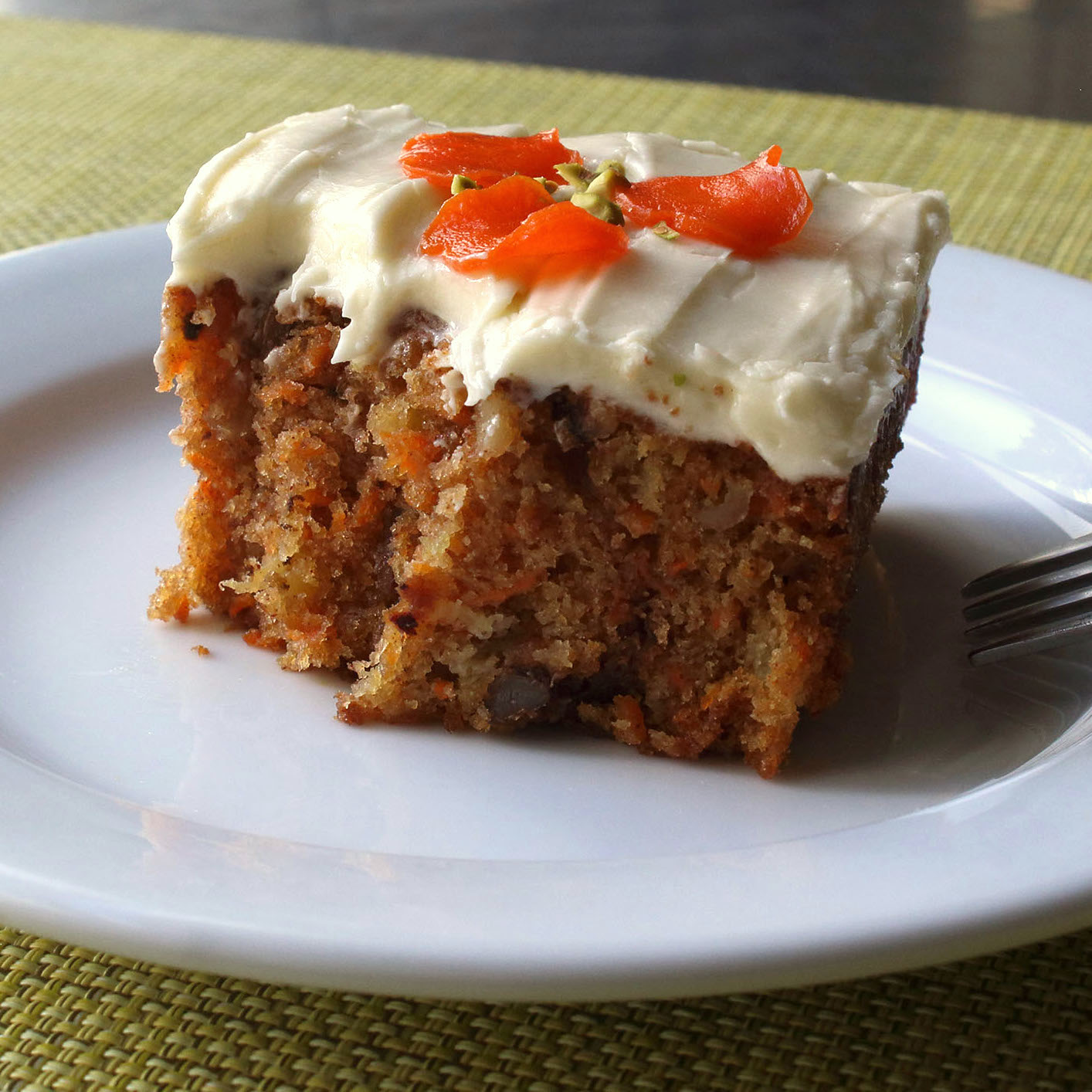 Chef John's carrot cake on a white plate with frosting