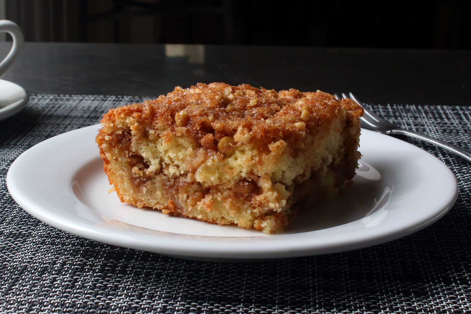 slice of apple crumble coffee cake on a plate