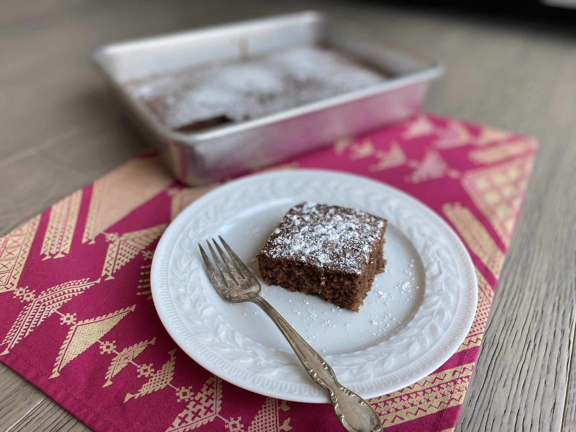 slice of waste not cake topped with powdered sugar