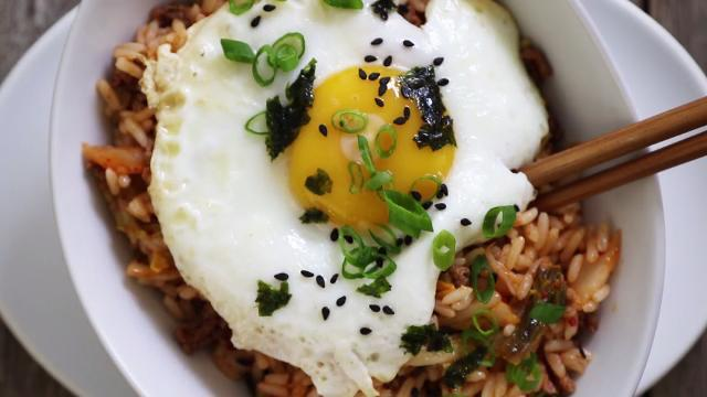 Close up on kimchi fried rice with an egg on top.
