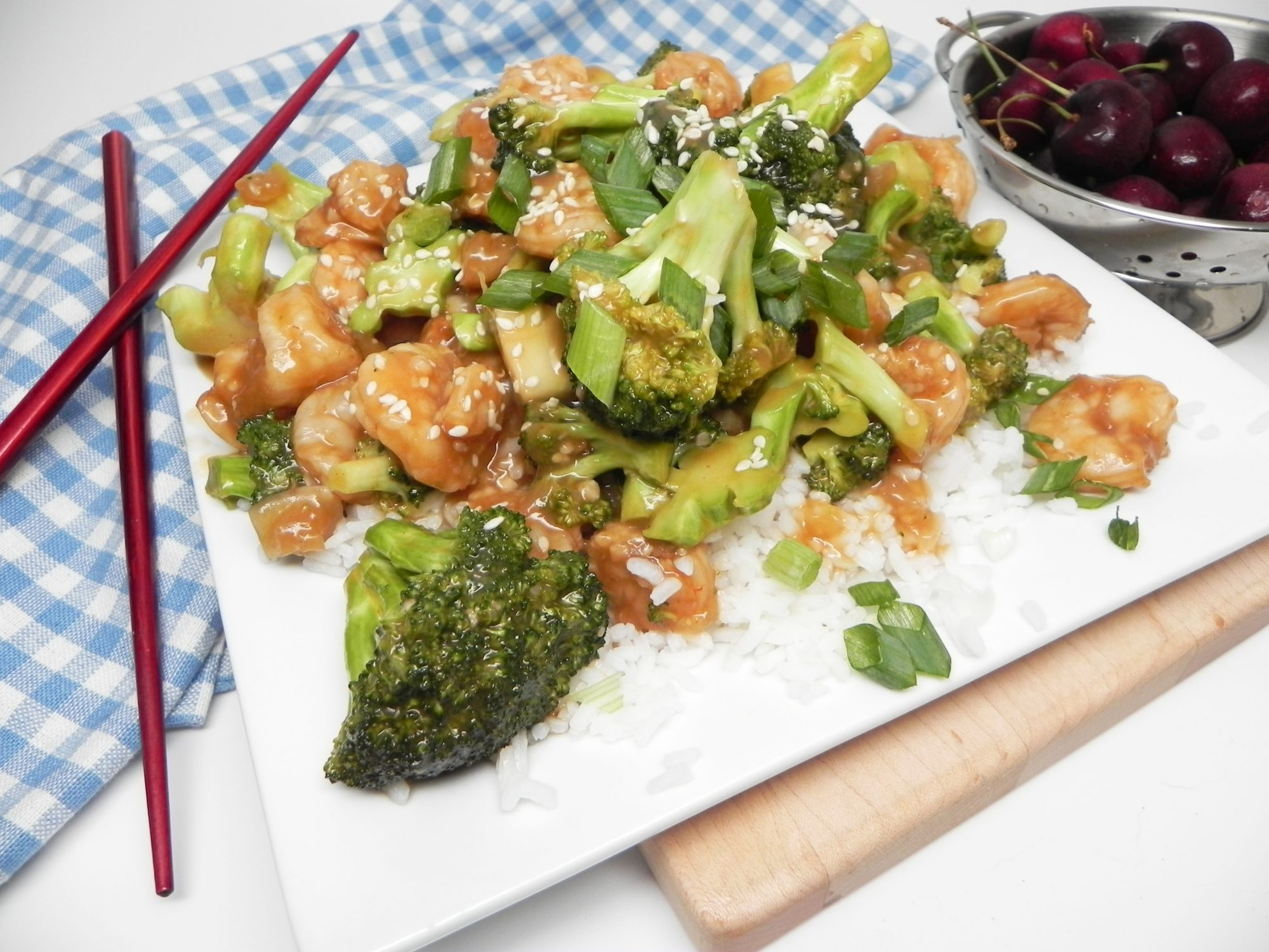 Instant Pot® Shrimp and Broccoli on a white plate with chopsticks