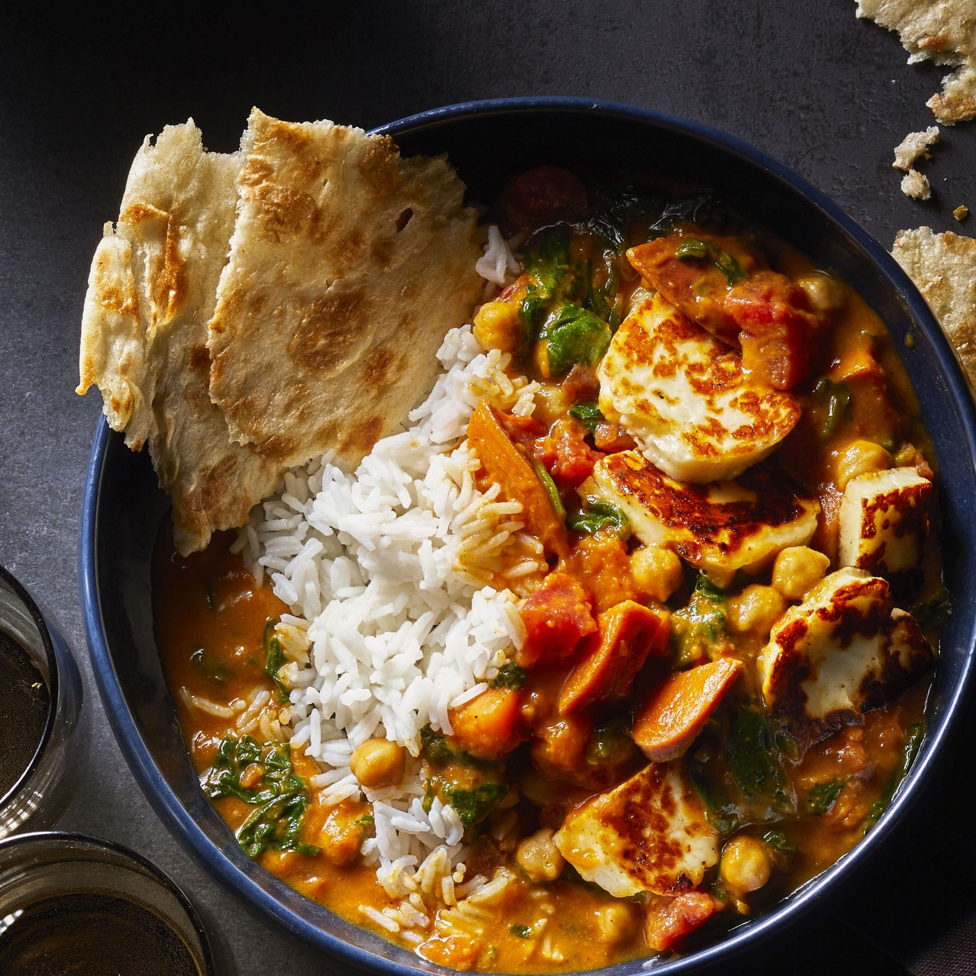 Sweet Potato, Spinach, and Halloumi Curry in a dark bowl