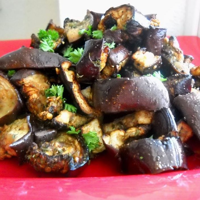 eggplant salad with parsley on a red plate