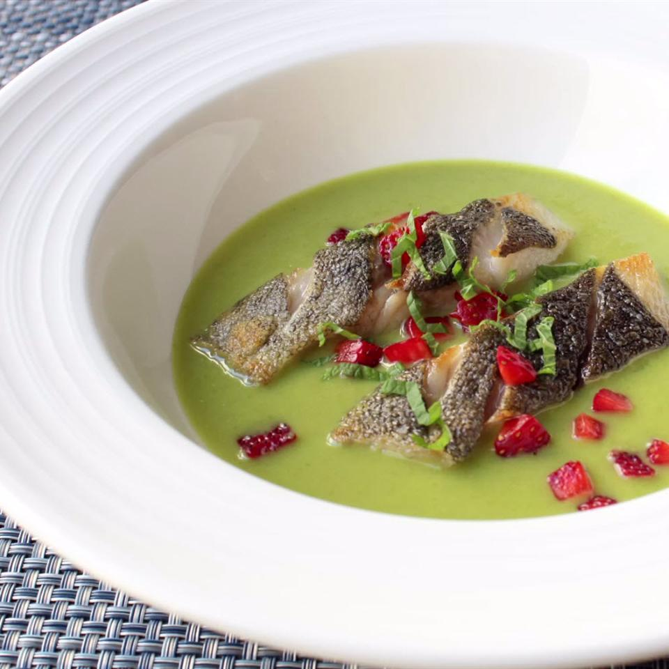 bowl of green curry with filets of black cod