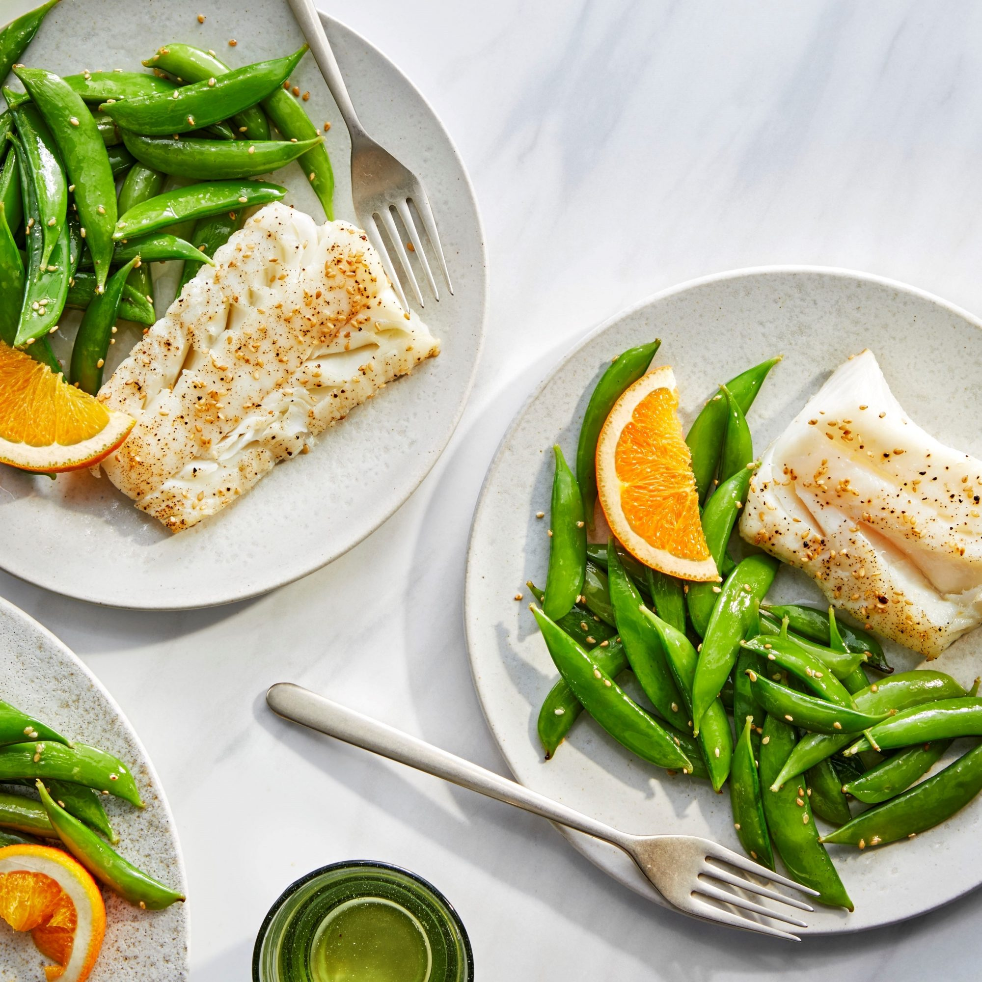 three plates of cod with snap peas