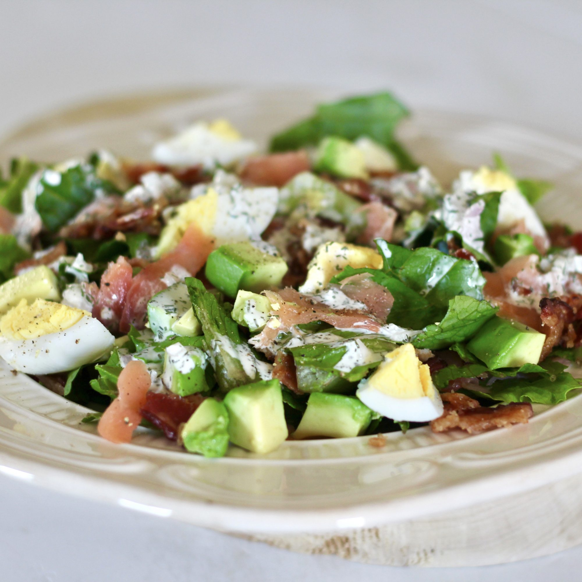 cobb salad with salmon and boiled eggs