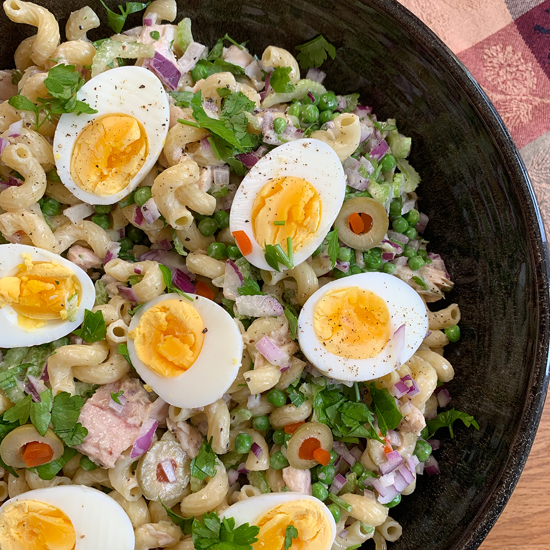 pasta salad with tuna, olives, and boiled egg halves